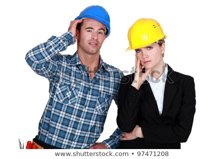 female architect looking annoyed and foreman by her side Stock photo © photography33
