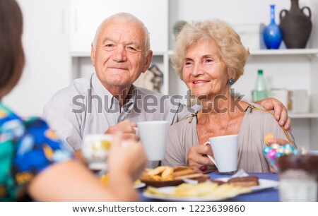 Elderly lady enjoying cup of tea Stock photo © photography33
