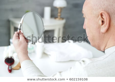 Bald man's head mirrored in a table Stock photo © photography33