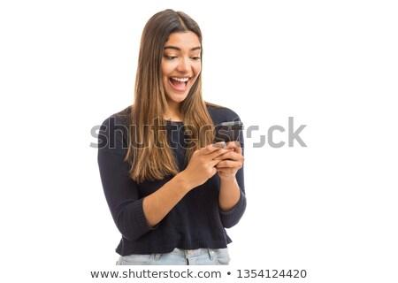 возбужденный брюнетка добрая весть лице телефон счастливым Сток-фото © photography33