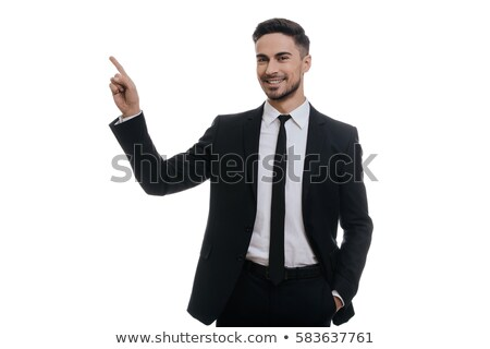Smiling man in suit pointing up against white background stock photo © wavebreak_media