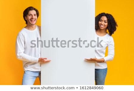 Mosolygó nő mutat fehér tábla fehér boldog női Stock fotó © wavebreak_media
