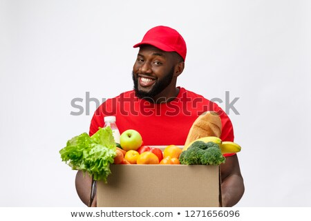 Happy delivery man carrying package stock photo © wavebreak_media