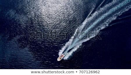Boat white wake on the blue ocean sea Stock photo © lunamarina