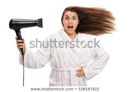 Woman using a hairdryer Stock photo © photography33
