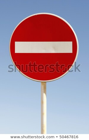Red and white british no entry road sign with a blue sky. Stock photo © latent