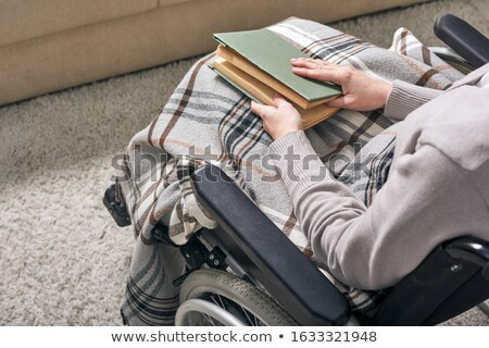 Disabled Adult Woman In Wheelchair Reading A Book Stock photo © Pressmaster