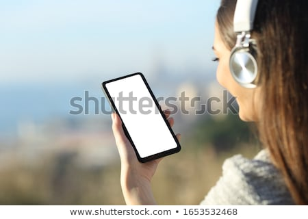 jonge · vrouw · hoofdtelefoon · telefoon · geïsoleerd · witte · meisje - stockfoto © maros_b