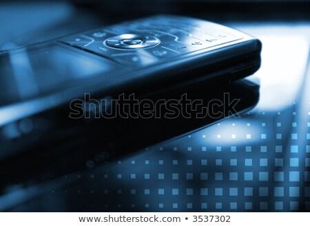 Niebieski zdjęcie telefonu komórkowego płytki koncentruje Zdjęcia stock © Nejron