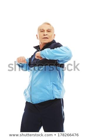 Senior man in training suit doing warm-up stretching exercises  Stock photo © Nejron