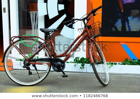 Stylish womens blue bicycle isolated on black Stock photo © vlad_star