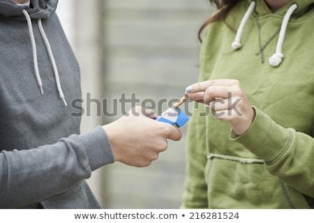 Nino ofrecimiento cigarrillo aire libre adolescente Foto stock © HighwayStarz