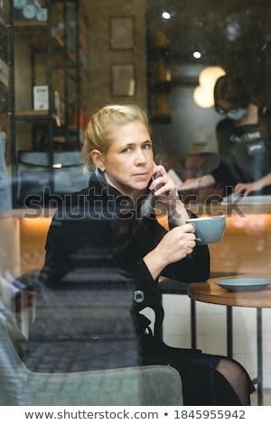 close up blond woman calling through phone stock photo © dash