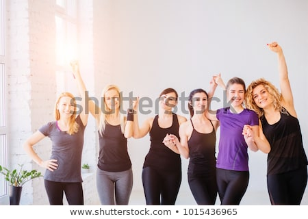 Woman in sport clothes practice with hand weights Stock photo © HASLOO