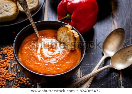 tomato soup in yellow plate stock photo © Marfot