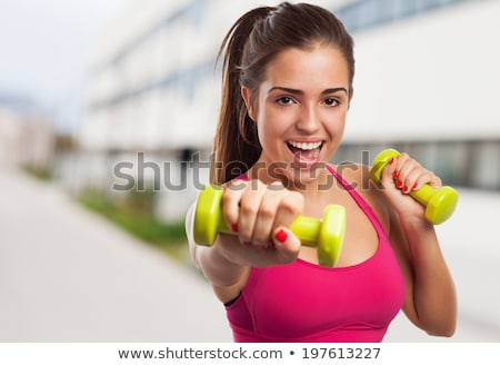sporty girl holding weights stock photo © hasloo