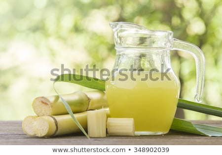 brown cane sugar cubes on wooden backgroundmacro stock photo © ironstealth