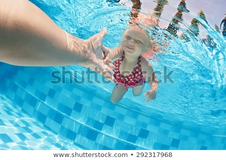 adult and children hands holding underwater stock photo © lunamarina