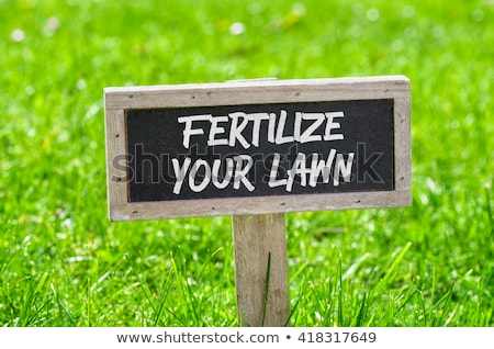 Sign on a green lawn - Fertilize your lawn Stock photo © Zerbor