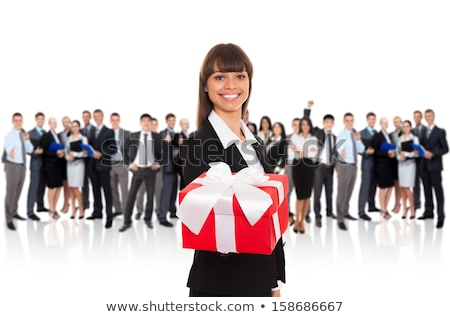 smiling man handing over a large gift box stock photo © ozgur