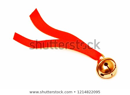 Two gold Christmas jingle bell with red ribbon Stock photo © orensila