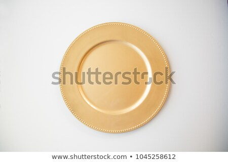 Round gold charger plate Stock photo © Digifoodstock