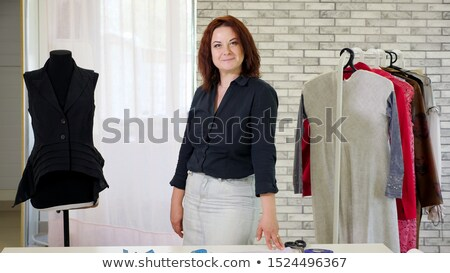 Woman with hangers in parlour Stock photo © dash