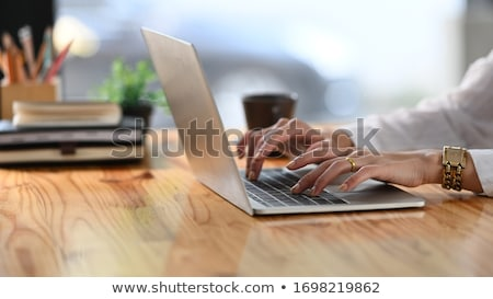 Cropped image of Woman Surrounded by plants Stock photo © deandrobot