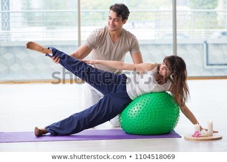 terhes · nő · nyújtás · fitnessz · labda · előad · láb - stock fotó © kzenon