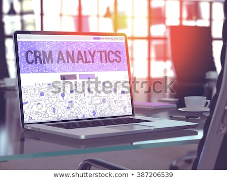 Landing Page of Laptop with Crm Analytics Concept. 3D. Stock photo © tashatuvango