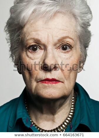 stuido portrait of serious senior woman stock photo © is2