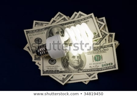 Stockfoto: Compact Fluorescent Lightbulb And Dollar
