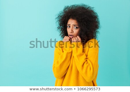 cute american woman in colorful shirt with shaggy hair looking o stock photo © deandrobot