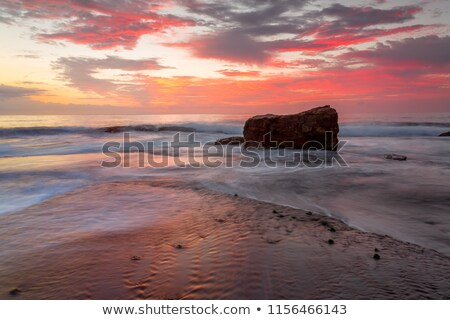 Tidal flows at sunrise on Turimetta reef Stock photo © lovleah