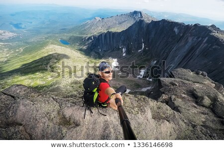 Self-portrait of a hiker in the top of the mountain Stock photo © ruslanshramko