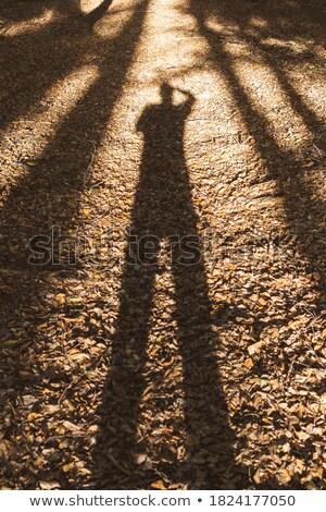 Ombre persone paura uomo piedi seduta Foto d'archivio © AndreyPopov