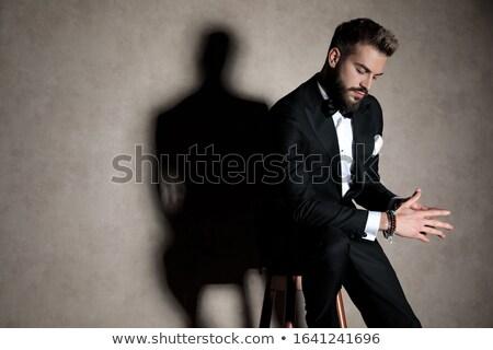 Moda ragazzo seduta sgabello holding hands insieme Foto d'archivio © feedough