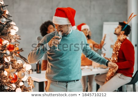 man with bottle of champagne at christmas party Stock photo © dolgachov