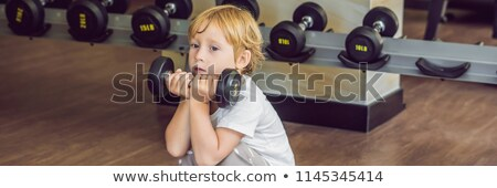 A boy lifts up to, a dumbbell in the gym BANNER, long format stock photo © galitskaya