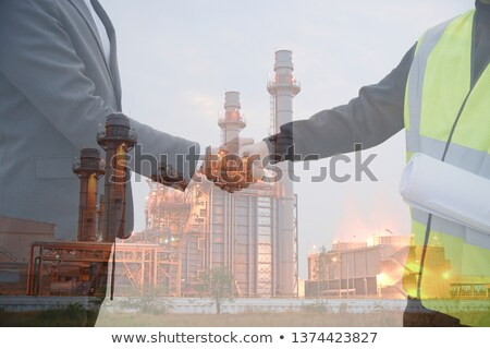 Worker and investor in solar power plant Stock photo © Kzenon