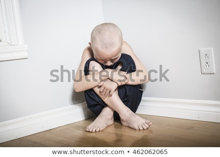 Neglected lonely child leaning at the wall Stock photo © Lopolo