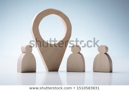 Human Figures And Wooden Navigation Sign Against Background Stock photo © AndreyPopov