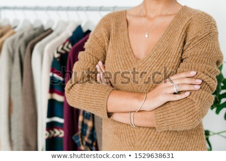 Mid-section of young shop assistant in casual knitted beige pullover Stock photo © pressmaster