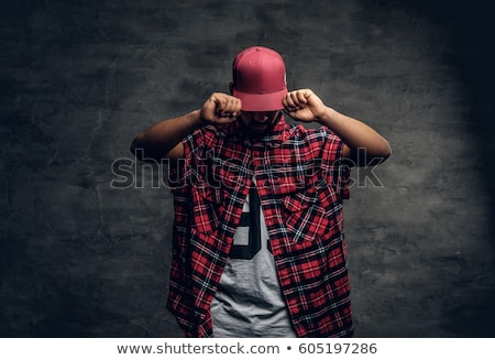 young man in red hoodie over grey background Stock photo © dolgachov