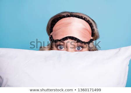 Beautiful blonde on the bed with a pillow in my arms early in the morning on a white background Stock photo © ElenaBatkova