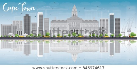 Cape town skyline with grey buildings, blue sky and reflection. Stock photo © ShustrikS