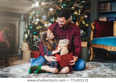 Small female child holds teddy bear, recieves unexpected gift fr Stock photo © vkstudio