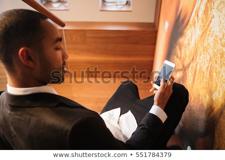 Lying on back businessman with phone Stock photo © Paha_L
