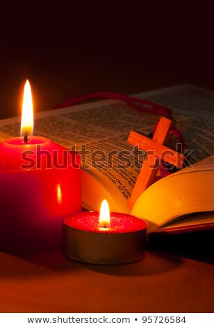 Open Bible with cross and burning candles Stock photo © AndreyKr