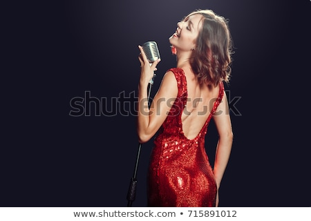 young female singer with microphone stock photo © photography33